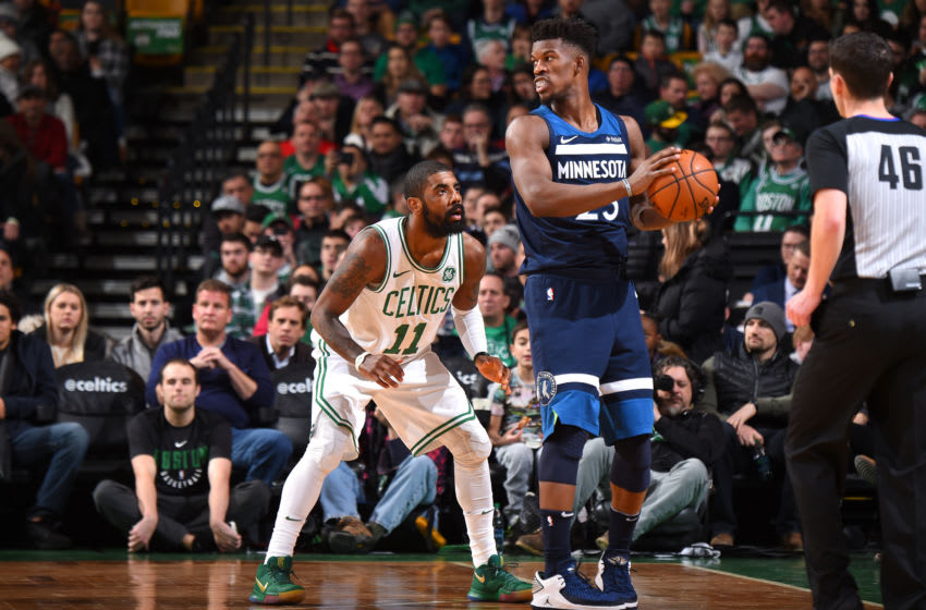 BOSTON, MA - JANUARY 5: Jimmy Butler #23 of the Minnesota Timberwolves handles the ball against Kyrie Irving #11 of the Boston Celtics on January 5, 2018 at the TD Garden in Boston, Massachusetts. NOTE TO USER: User expressly acknowledges and agrees that, by downloading and or using this photograph, User is consenting to the terms and conditions of the Getty Images License Agreement. Mandatory Copyright Notice: Copyright 2018 NBAE (Photo by Brian Babineau/NBAE via Getty Images)