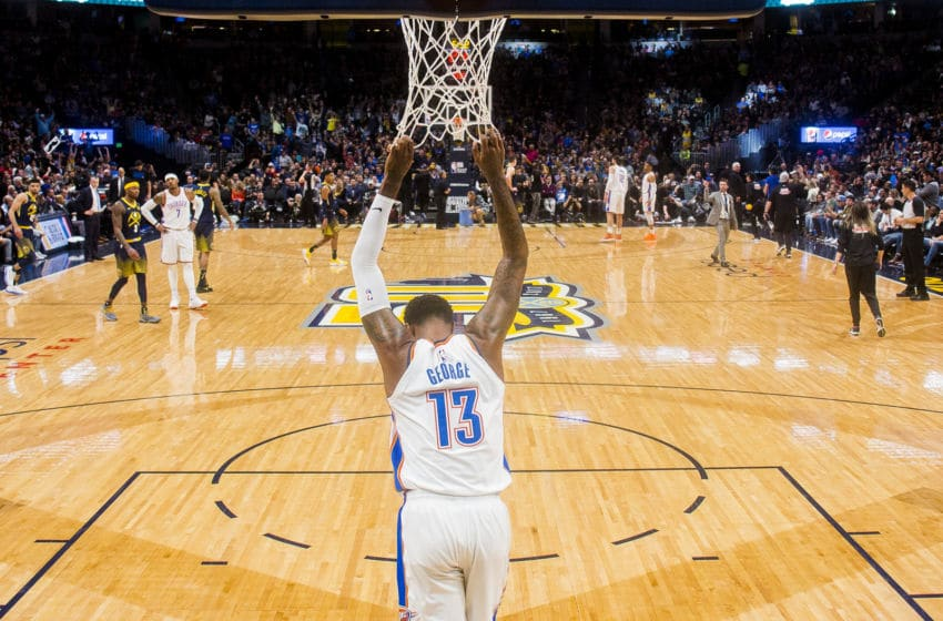DENVER, CO - FEBRUARY 01: Paul George #13 of the Oklahoma City Thunder pulls on the net during a timeout against the Denver Nuggets at Pepsi Center on February 1, 2018 in Denver, Colorado. NOTE TO USER: User expressly acknowledges and agrees that, by downloading and or using this photograph, User is consenting to the terms and conditions of the Getty Images License Agreement. (Photo by Timothy Nwachukwu/Getty Images)