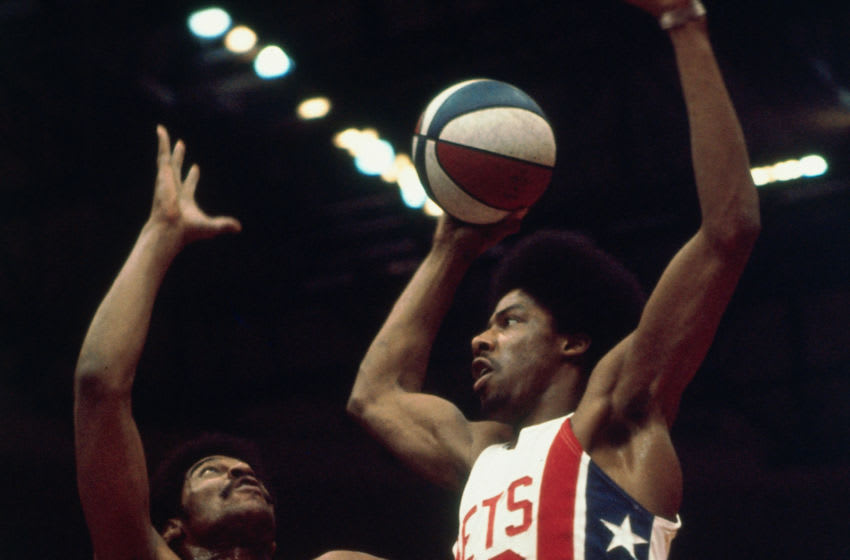 UNIONDALE, NY - 1974: Julius Erving #32 of the New York Nets goes to the basket against the Indiana Pacers circa 1974 at the Nassau Veterans Memorial Coliseum in Uniondale, New York. NOTE TO USER: User expressly acknowledges and agrees that, by downloading and/or using this photograph, user is consenting to the terms and conditions of the Getty Images License Agreement. Mandatory Copyright Notice: Copyright 1974 NBAE (Photo by Jim Cummins/NBAE via Getty Images)
