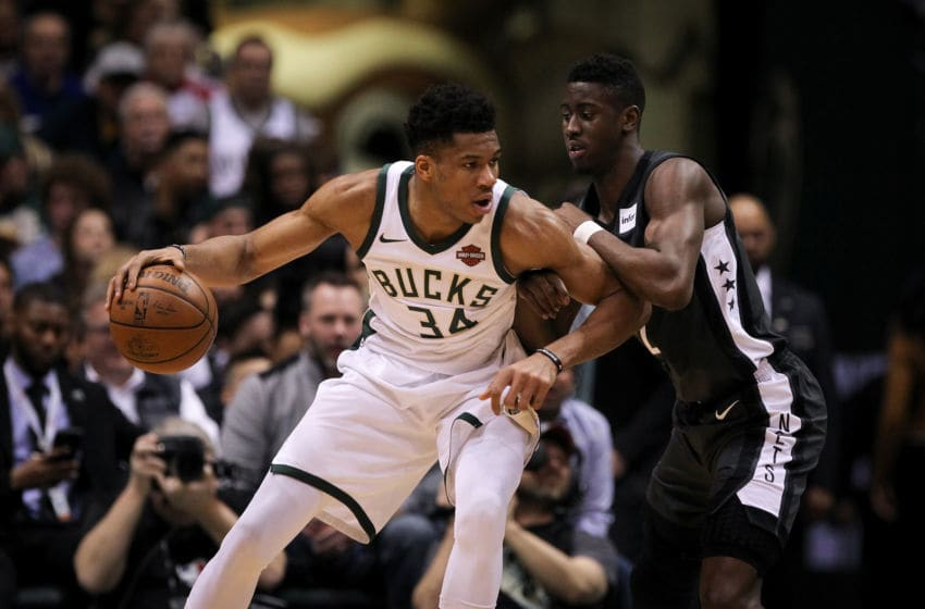 MILWAUKEE, WI - APRIL 05: Giannis Antetokounmpo #34 of the Milwaukee Bucks dribbles the ball while being guarded by Caris LeVert #22 of the Brooklyn Nets in the second quarter at the Bradley Center on April 5, 2018 in Milwaukee, Wisconsin. NOTE TO USER: User expressly acknowledges and agrees that, by downloading and or using this photograph, User is consenting to the terms and conditions of the Getty Images License Agreement. (Dylan Buell/Getty Images) *** Local Caption *** Giannis Antetokounmpo;Caris LeVert