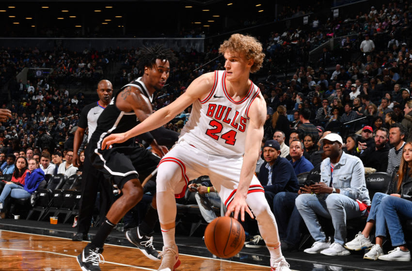 BROOKLYN, NY - APRIL 9: Lauri Markkanen #24 of the Chicago Bulls handles the ball during the game against the Brooklyn Nets on April 9, 2018 at Barclays Center in Brooklyn, New York. NOTE TO USER: User expressly acknowledges and agrees that, by downloading and/or using this Photograph, user is consenting to the terms and conditions of the Getty Images License Agreement. Mandatory Copyright Notice: Copyright 2018 NBAE (Photo by Jesse D. Garrabrant/NBAE via Getty Images)