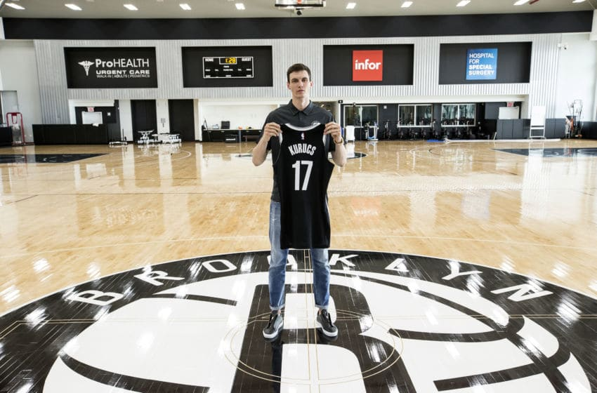 BROOKLYN, NY - JUNE 22: Brooklyn Nets Draft pick Rodions Kurucs poses for a photo at the Post NBA Draft press conference on June 22, 2018 at the HSS Training Center in Brooklyn, New York. NOTE TO USER: User expressly acknowledges and agrees that, by downloading and/or using this photograph, user is consenting to the terms and conditions of the Getty Images License Agreement. Mandatory Copyright Notice: Copyright 2018 NBAE (Photo by Michelle Farsi/NBAE via Getty Images)