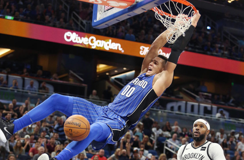 Orlando Magic forward Aaron Gordon has agreed to a four-year deal worth about $84 million to stay with the Magic. He is pictured here as he slam dunks over Brooklyn Nets forward Trevor Booker (35) at the Amway Center on Tuesday, October 24, 2017. (Stephen M. Dowell/Orlando Sentinel/TNS via Getty Images)