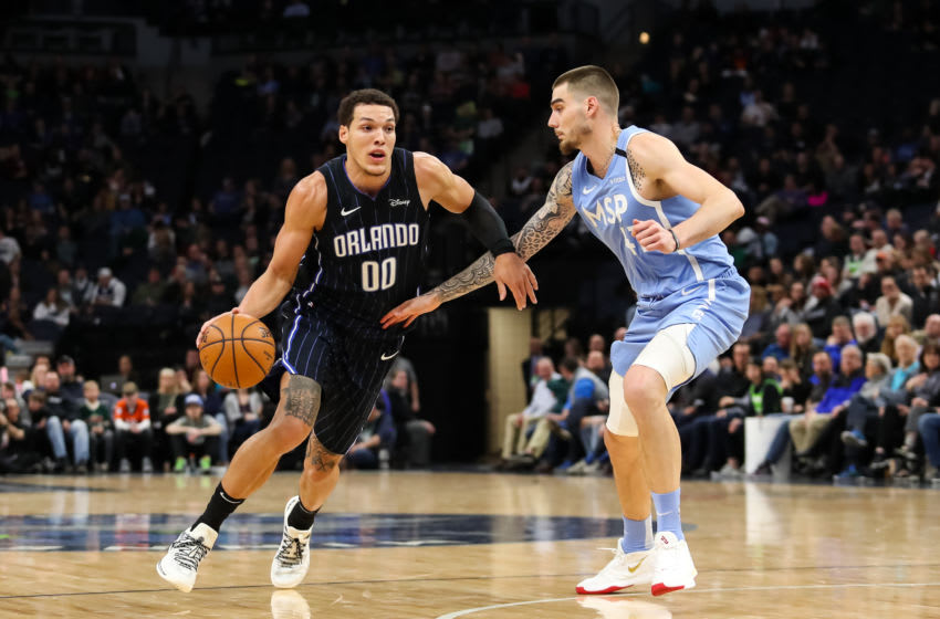MINNEAPOLIS, MN - MARCH 6: Aaron Gordon #00 of the Orlando Magic drives to the basket against Juan Hernangomez #41 of the Minnesota Timberwolves in the third quarter of the game at Target Center on March 6, 2020 in Minneapolis, Minnesota. The Magic defeated the Timberwolves 132-118. NOTE TO USER: User expressly acknowledges and agrees that, by downloading and or using this Photograph, user is consenting to the terms and conditions of the Getty Images License Agreement. (Photo by David Berding/Getty Images)