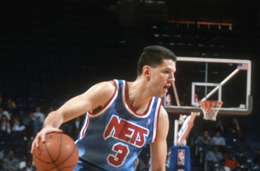LANDOVER, MD - CIRCA 1991: Drazen Petrovic #3 of the New Jersey Nets dribbles the ball against the Washington Bullets during an NBA basketball game circa 1991 at the Capital Centre in Landover, Maryland. Petrovic played for the Nets from 1991-93. (Photo by Focus on Sport/Getty Images) *** Local Caption *** Drazen Petrovic