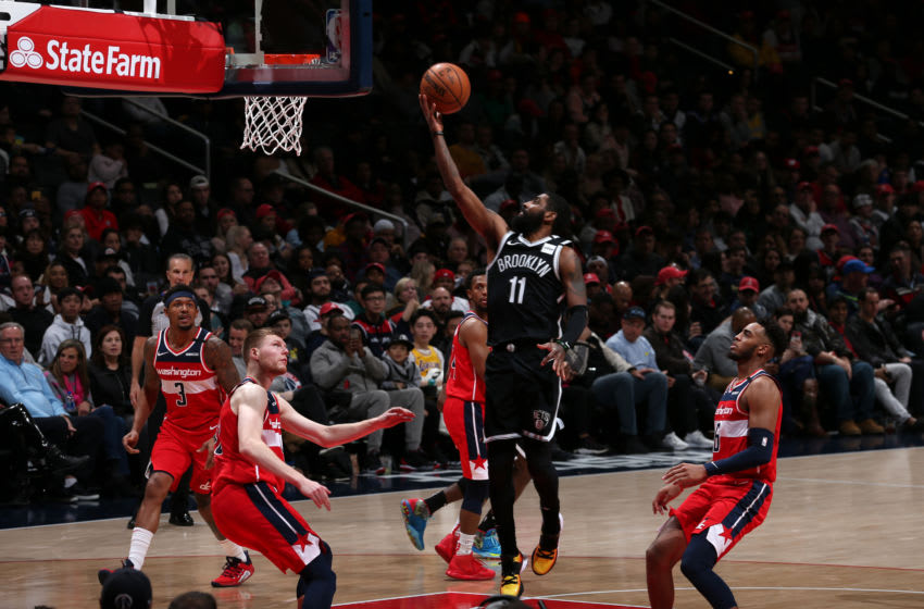 WASHINGTON, DC - FEBRUARY 1: Kyrie Irving #11 of the Brooklyn Nets drives to the basket against the Washington Wizards on February 1, 2020 at Capital One Arena in Washington, DC. NOTE TO USER: User expressly acknowledges and agrees that, by downloading and or using this Photograph, user is consenting to the terms and conditions of the Getty Images License Agreement. Mandatory Copyright Notice: Copyright 2020 NBAE (Photo by Ned Dishman/NBAE via Getty Images)