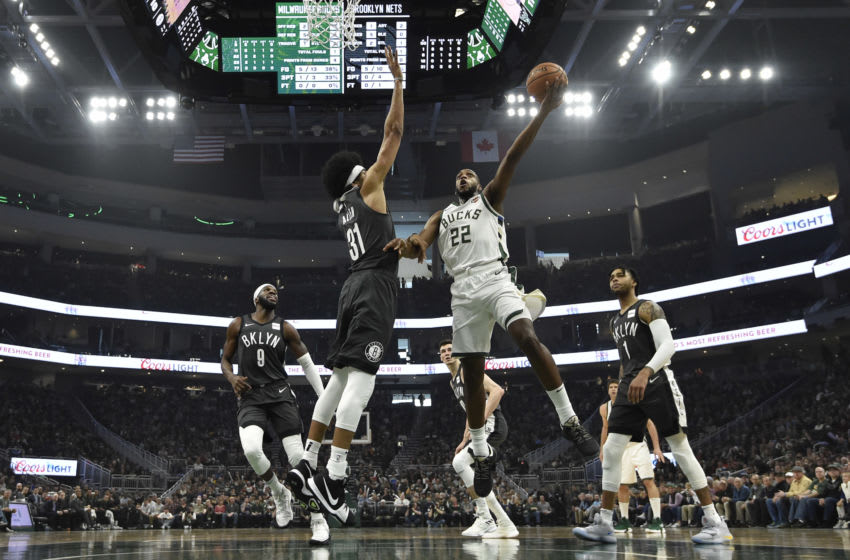 MILWAUKEE, WISCONSIN - APRIL 06: Khris Middleton #22 of the Milwaukee Bucks shoots a lay up in the first half Jarrett Allen #31 of the Brooklyn Nets at Fiserv Forum on April 06, 2019 in Milwaukee, Wisconsin. NOTE TO USER: User expressly acknowledges and agrees that, by downloading and or using this photograph, User is consenting to the terms and conditions of the Getty Images License Agreement. (Photo by Quinn Harris/Getty Images)