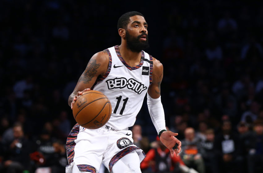 Nets point guard Kyrie Irving (Photo by Mike Stobe/Getty Images)