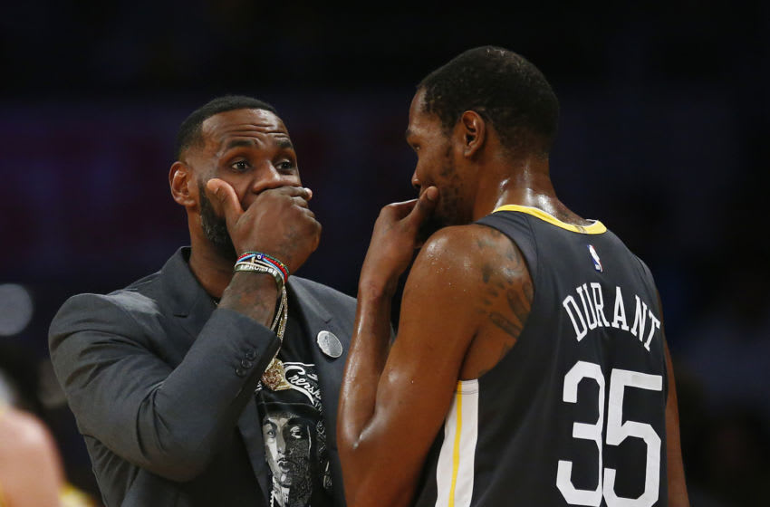 LOS ANGELES, CALIFORNIA - APRIL 04: LeBron James #23 of the Los Angeles Lakers speaks to Kevin Durant #35 of the Golden State Warriors during a timeout in the first half at Staples Center on April 04, 2019 in Los Angeles, California. NOTE TO USER: User expressly acknowledges and agrees that, by downloading and or using this photograph, User is consenting to the terms and conditions of the Getty Images License Agreement. (Photo by Yong Teck Lim/Getty Images)