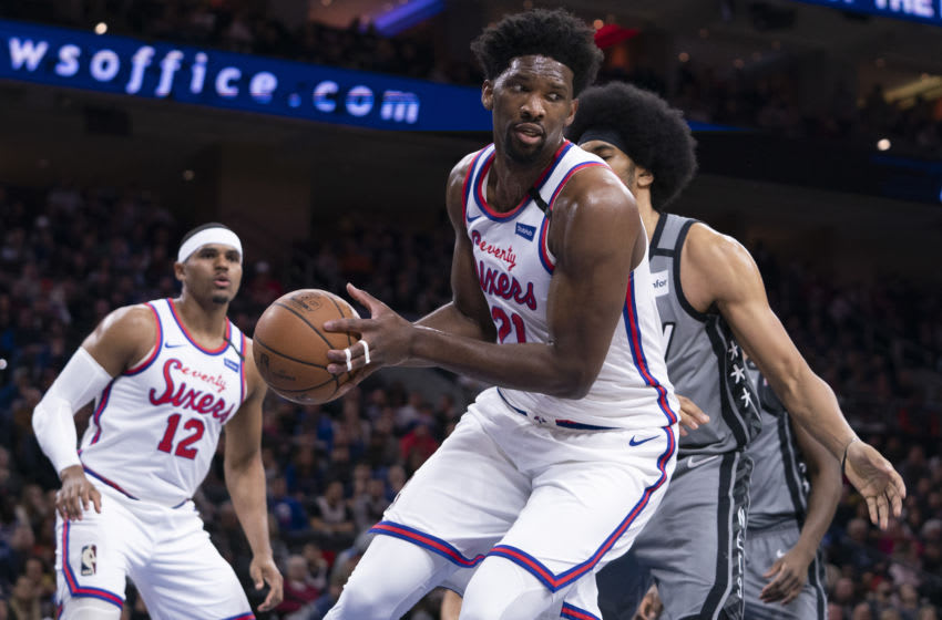 PHILADELPHIA, PA - FEBRUARY 20: Joel Embiid #21 of the Philadelphia 76ers controls the ball against the Brooklyn Nets at the Wells Fargo Center on February 20, 2020 in Philadelphia, Pennsylvania. The 76ers defeated the Nets 112-104 in overtime. NOTE TO USER: User expressly acknowledges and agrees that, by downloading and/or using this photograph, user is consenting to the terms and conditions of the Getty Images License Agreement. (Photo by Mitchell Leff/Getty Images)