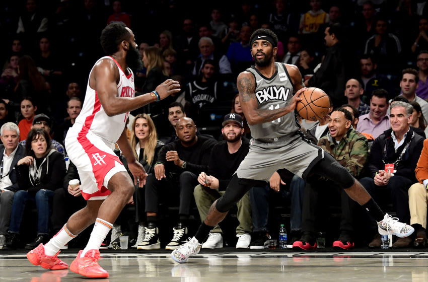NEW YORK, NEW YORK - NOVEMBER 01: Kyrie Irving #11 of the Brooklyn Nets is defended by James Harden #13 of the Houston Rockets (Photo by Steven Ryan/Getty Images)