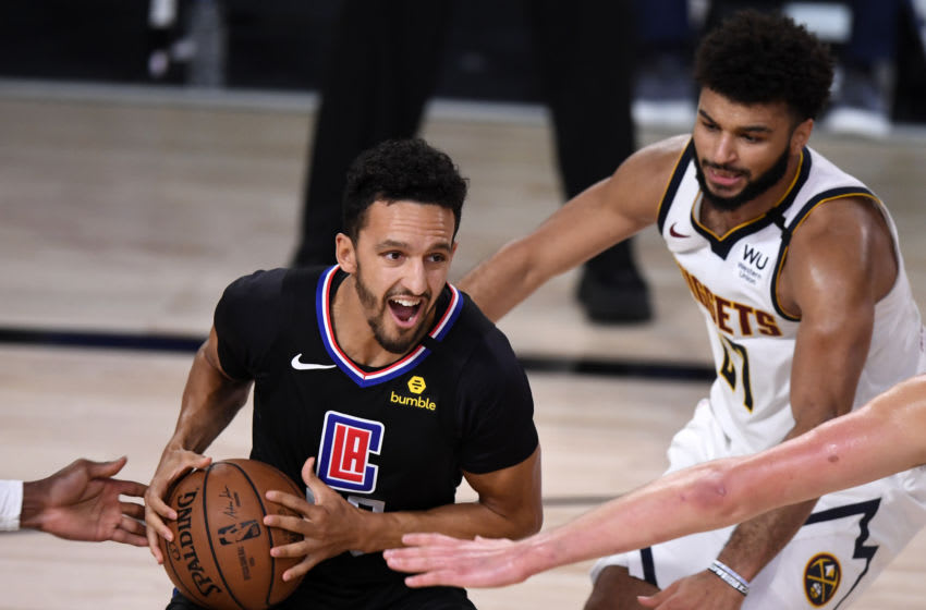 LAKE BUENA VISTA, FLORIDA - SEPTEMBER 05: Landry Shamet #20 of the LA Clippers drives the ball against Jamal Murray #27 of the Denver Nuggets during the third quarter in Game Two of the Western Conference Second Round during the 2020 NBA Playoffs at AdventHealth Arena at the ESPN Wide World Of Sports Complex on September 05, 2020 in Lake Buena Vista, Florida. NOTE TO USER: User expressly acknowledges and agrees that, by downloading and or using this photograph, User is consenting to the terms and conditions of the Getty Images License Agreement. (Photo by Douglas P. DeFelice/Getty Images)