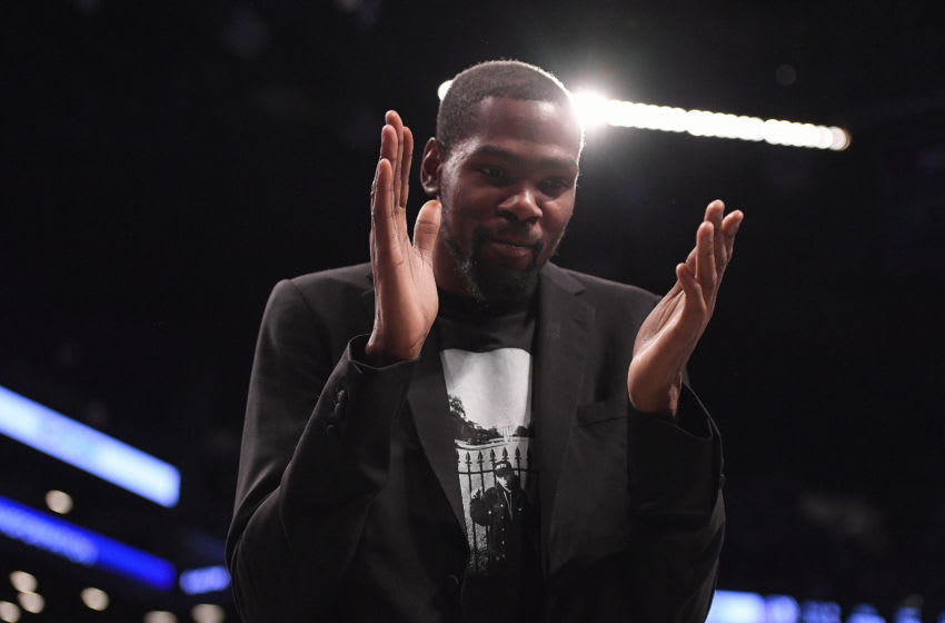 NEW YORK, NEW YORK - DECEMBER 15: Kevin Durant #7 of the Brooklyn Nets reacts during the game against the Philadelphia 76ers at Barclays Center on December 15, 2019 in New York City. NOTE TO USER: User expressly acknowledges and agrees that, by downloading and or using this photograph, User is consenting to the terms and conditions of the Getty Images License Agreement. (Photo by Matteo Marchi/Getty Images)