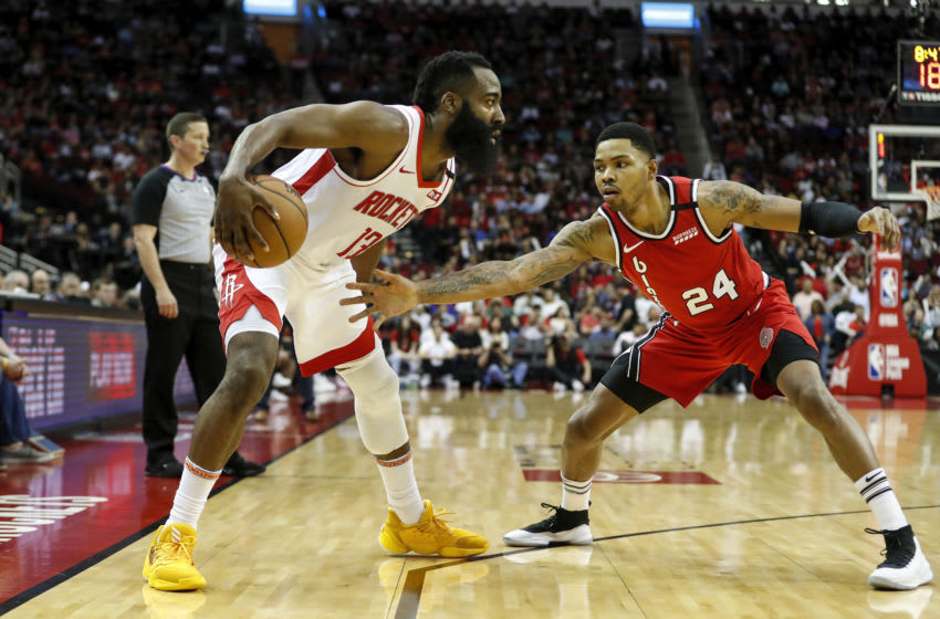 HOUSTON, TEXAS - JANUARY 15: James Harden #13 of the Houston Rockets controls the ball defended by Kent Bazemore #24 of the Portland Trail Blazers (Photo by Tim Warner/Getty Images)