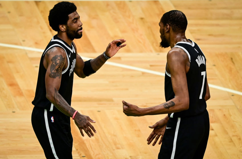 BOSTON, MASSACHUSETTS - MAY 30: Kyrie Irving #11 of the Brooklyn Nets reacts with teammate Kevin Durant #7 (Photo by Maddie Malhotra/Getty Images)
