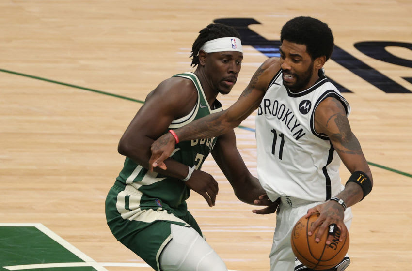 MILWAUKEE, WISCONSIN - MAY 02: Kyrie Irving #11 of the Brooklyn Nets is defended by Jrue Holiday #21 of the Milwaukee Bucks during a game at Fiserv Forum on May 02, 2021 in Milwaukee, Wisconsin. NOTE TO USER: User expressly acknowledges and agrees that, by downloading and or using this photograph, User is consenting to the terms and conditions of the Getty Images License Agreement. (Photo by Stacy Revere/Getty Images)