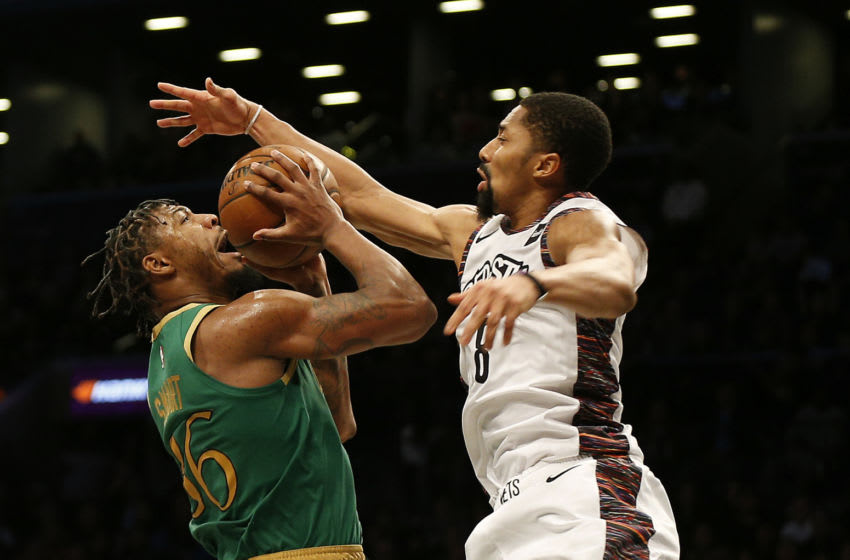 Nov 29, 2019; Brooklyn, NY, USA; Boston Celtics guard Marcus Smart (36) goes up for a shot while being fouled by Brooklyn Nets guard Spencer Dinwiddie (8) during the second half at Barclays Center. Mandatory Credit: Andy Marlin-USA TODAY Sports