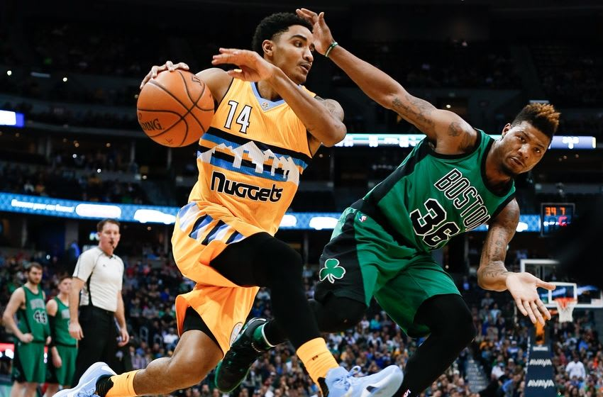Feb 21, 2016; Denver, CO, USA; Denver Nuggets guard Gary Harris (14) dribbles the ball against Boston Celtics guard Marcus Smart (36) in the third quarter at the Pepsi Center. The Celtics defeated the Nuggets 121-101. Mandatory Credit: Isaiah J. Downing-USA TODAY Sports