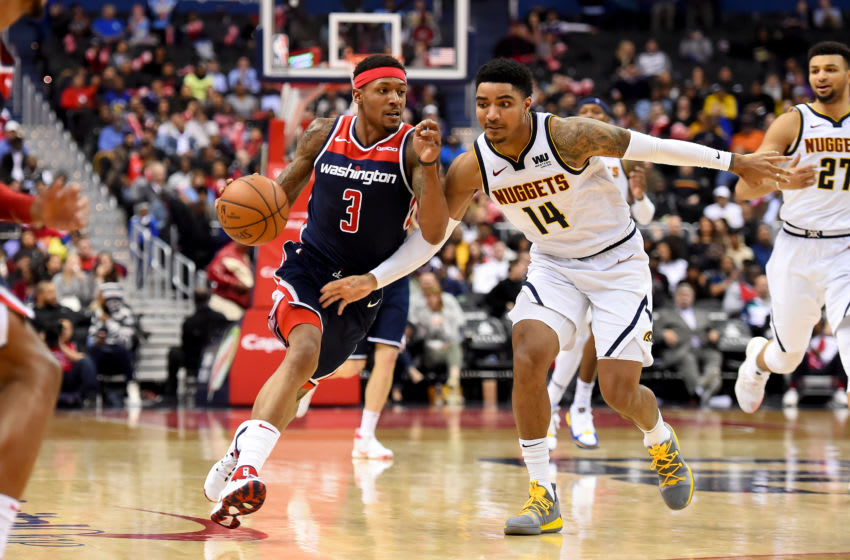 WASHINGTON, DC - MARCH 21: Bradley Beal #3 of the Washington Wizards dribbles in front of Gary Harris #14 of the Denver Nuggets during the second half at Capital One Arena on March 21, 2019 in Washington, DC. NOTE TO USER: User expressly acknowledges and agrees that, by downloading and or using this photograph, User is consenting to the terms and conditions of the Getty Images License Agreement. (Photo by Will Newton/Getty Images)