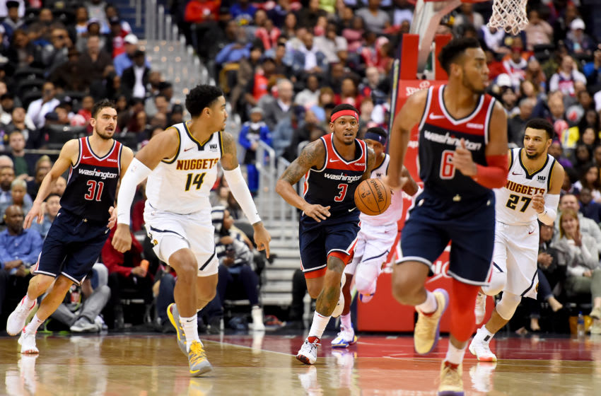 WASHINGTON, DC - MARCH 21: Bradley Beal #3 of the Washington Wizards dribbles against the Denver Nuggets during the second half at Capital One Arena on March 21, 2019 in Washington, DC. NOTE TO USER: User expressly acknowledges and agrees that, by downloading and or using this photograph, User is consenting to the terms and conditions of the Getty Images License Agreement. (Photo by Will Newton/Getty Images)