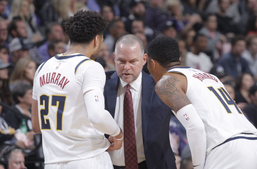 SACRAMENTO, CA - OCTOBER 28: Head coach Michael Malone of the Denver Nuggets coaches Jamal Murray #27 and Gary Harris #14 against the Sacramento Kings on October 28, 2019 at Golden 1 Center in Sacramento, California. NOTE TO USER: User expressly acknowledges and agrees that, by downloading and or using this photograph, User is consenting to the terms and conditions of the Getty Images Agreement. Mandatory Copyright Notice: Copyright 2019 NBAE (Photo by Rocky Widner/NBAE via Getty Images)