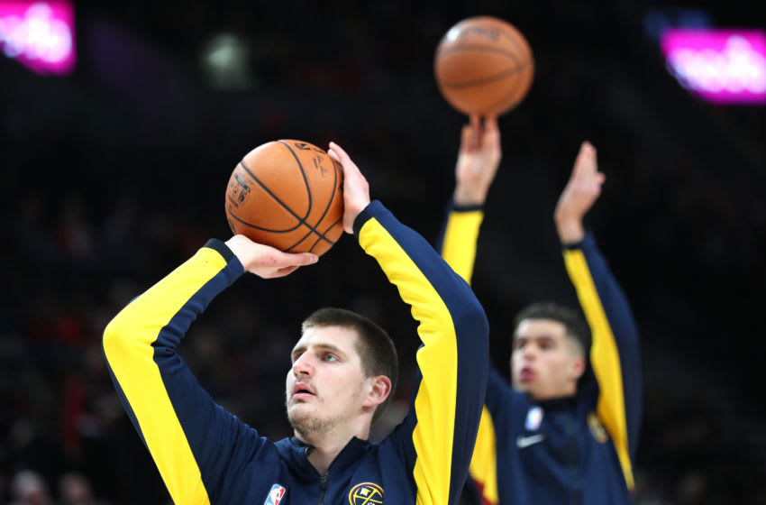 PORTLAND, OREGON - OCTOBER 23: Nikola Jokic #15 (front) warms up alongside Michael Porter Jr. #1 of the Denver Nuggets prior to taking on the Portland Trail Blazers during their season opener at Moda Center on October 23, 2019 in Portland, Oregon. NOTE TO USER: User expressly acknowledges and agrees that, by downloading and or using this photograph, User is consenting to the terms and conditions of the Getty Images License Agreement (Photo by Abbie Parr/Getty Images)