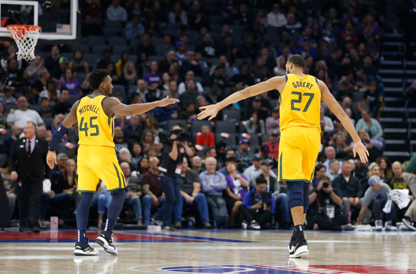 SACRAMENTO, CA - NOVEMBER 01: Donovan Mitchell #45 and Rudy Gobert #27 of the Utah Jazz react after a play against the Sacramento Kings at Golden 1 Center on November 01, 2019 in Sacramento, California. NOTE TO USER: User expressly acknowledges and agrees that, by downloading and/or using this photograph, user is consenting to the terms and conditions of the Getty Images License Agreement. (Photo by Lachlan Cunningham/Getty Images)