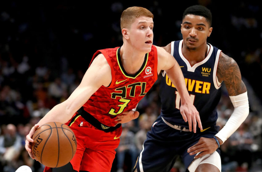 DENVER, COLORADO - NOVEMBER 12: Kevin Huerter #3 of the Atlanta Hawks drives against Gary Harris #14 of the Denver Nuggets in the first quarter at the Pepsi Center on November 12, 2019 in Denver, Colorado. NOTE TO USER: User expressly acknowledges and agrees that, by downloading and or using this photograph, User is consenting to the terms and conditions of the Getty Images License Agreement. (Photo by Matthew Stockman/Getty Images)