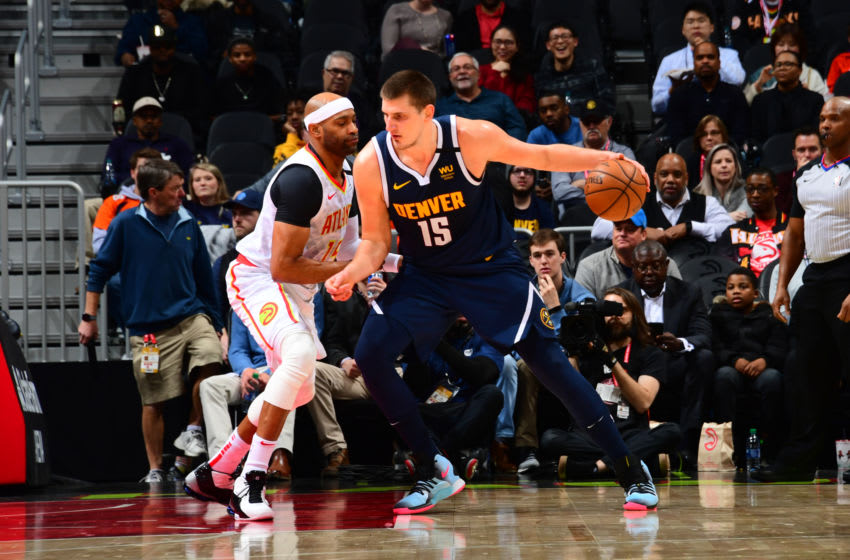 Nikola Jokic backs down Vince Carter (Photo by Scott Cunningham/NBAE via Getty Images)