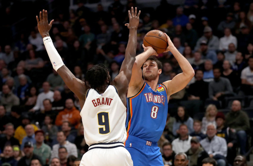 DENVER, COLORADO - DECEMBER 14: Danilo Gallinari #8 of the Oklahoma City Thunder puts up a shot over Jerami Grant #9 of the Denver Nuggets in the second quarter at Pepsi Center on December 14, 2019 in Denver, Colorado. NOTE TO USER: User expressly acknowledges and agrees that, by downloading and or using this photograph, User is consenting to the terms and conditions of the Getty Images License Agreement. (Photo by Matthew Stockman/Getty Images)