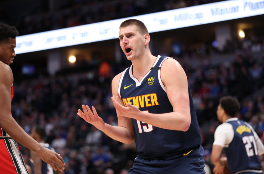Nikola Jokic asks for a foul (Photo by Justin Tafoya/Getty Images)