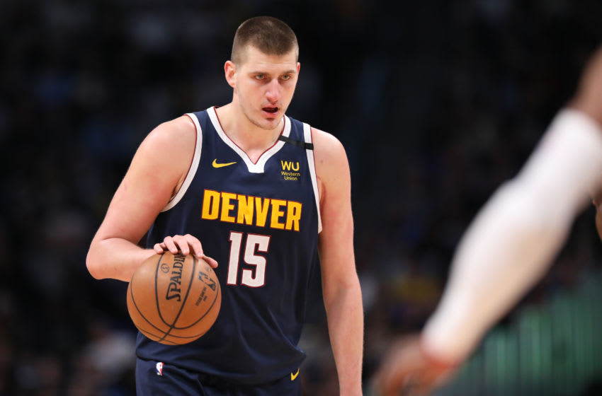 DENVER, CO - FEBRUARY 04: Nikola Jokic #15 of the Denver Nuggets dribbles the ball against the Portland Trail Blazers at Pepsi Center on February 4, 2020 in Denver, Colorado. NOTE TO USER: User expressly acknowledges and agrees that, by downloading and/or using this photograph, user is consenting to the terms and conditions of the Getty Images License Agreement (Photo by Justin Tafoya/Getty Images)