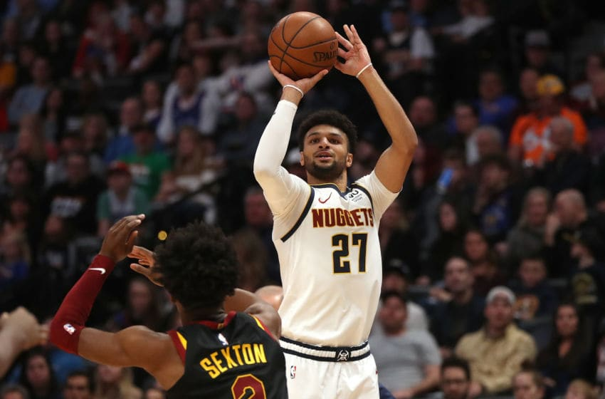 DENVER, COLORADO - JANUARY 11: Jamal Murray #27 of the Denver Nuggets puts up a shot against Collin Sexton #2 of the Cleveland Cavaliers in the second quarter at the Pepsi Center on January 11, 2020 in Denver, Colorado. NOTE TO USER: User expressly acknowledges and agrees that, by downloading and or using this photograph, User is consenting to the terms and conditions of the Getty Images License Agreement. (Photo by Matthew Stockman/Getty Images)