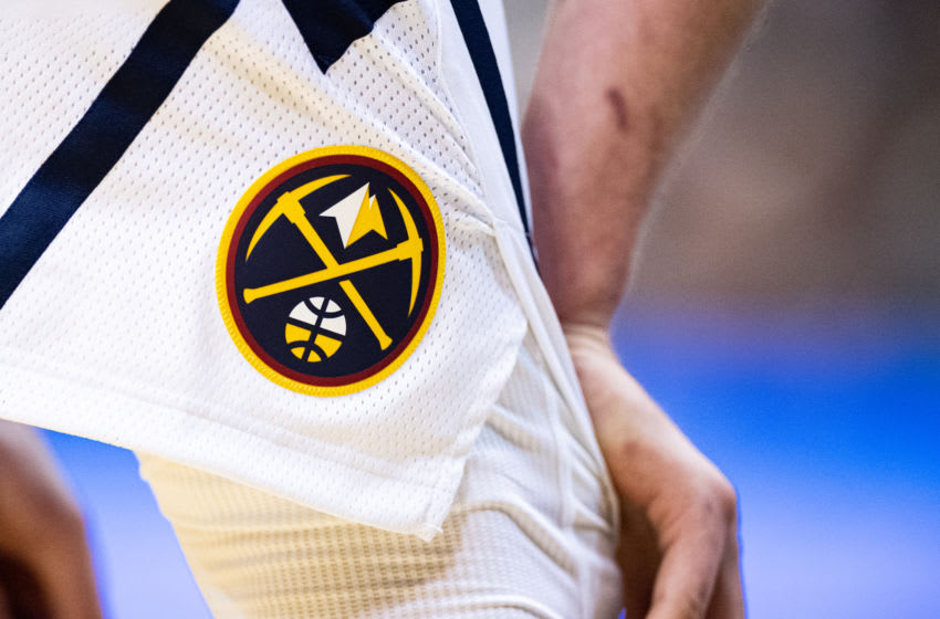 CHARLOTTE, NORTH CAROLINA - MARCH 05: The Denver Nuggets logo on the shorts of Nikola Jokic #15 of the Denver Nuggets during the fourth quarter during their game against the Charlotte Hornets at Spectrum Center on March 05, 2020 in Charlotte, North Carolina. NOTE TO USER: User expressly acknowledges and agrees that, by downloading and/or using this photograph, user is consenting to the terms and conditions of the Getty Images License Agreement. (Photo by Jacob Kupferman/Getty Images)
