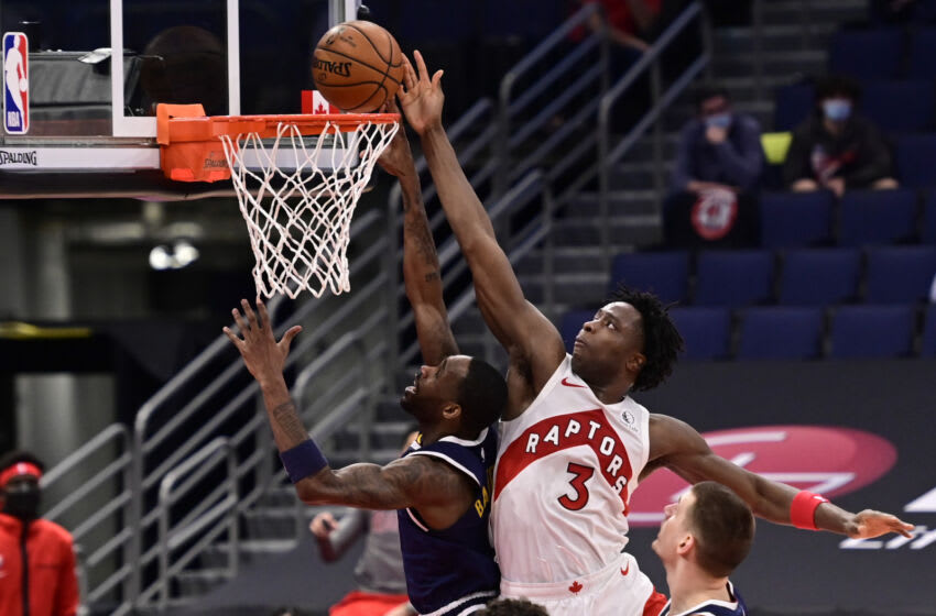 OG Anunoby of the Toronto Raptors tips the ball into the basket over Will Barton of the Denver Nuggets during the second quarter at Amalie Arena on 24 Mar. 2021 in Tampa, Florida. (Photo by Douglas P. DeFelice/Getty Images)