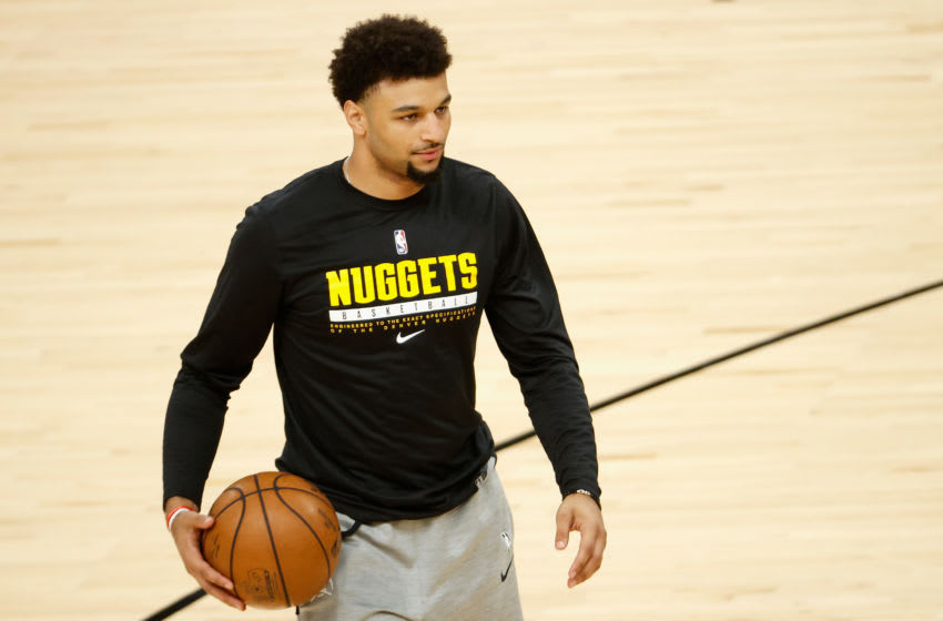 Jamal Murray of the Denver Nuggets warms up on the court while nursing an injury. (Photo by Christian Petersen/Getty Images)
