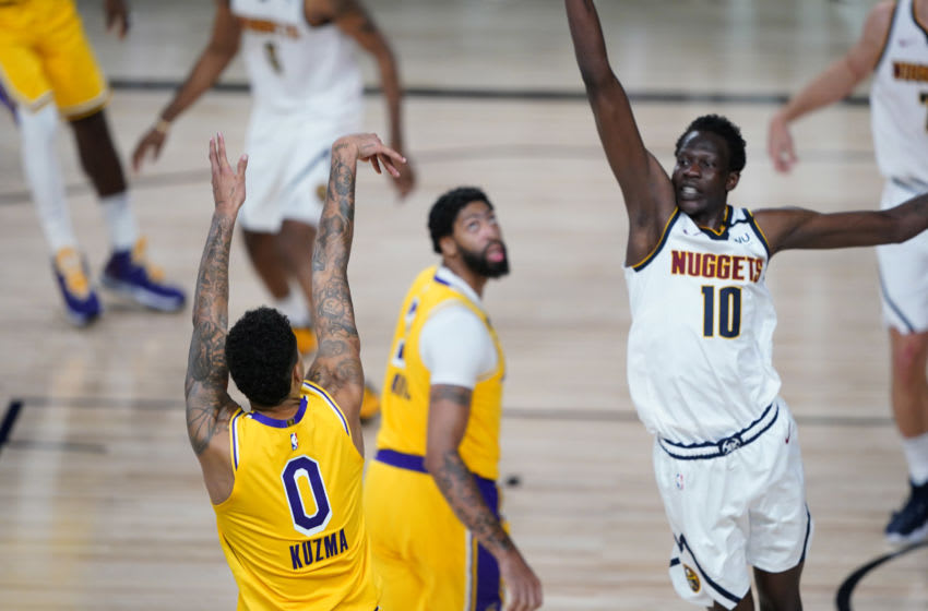 LAKE BUENA VISTA, FLORIDA - AUGUST 10: Kyle Kuzma #0 of the Los Angeles Lakers follows through on his game-winning three-pointer over Bol Bol #10 of the Denver Nuggets during the second half at The Arena at ESPN Wide World Of Sports Complex on August 10, 2020 in Lake Buena Vista, Florida. NOTE TO USER: User expressly acknowledges and agrees that, by downloading and or using this photograph, User is consenting to the terms and conditions of the Getty Images License Agreement. (Photo by Ashley Landis-Pool/Getty Images)