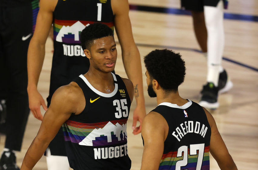 LAKE BUENA VISTA, FLORIDA - AUGUST 25: Jamal Murray #27 of the Denver Nuggets and PJ Dozier #35 of the Denver Nuggets react after their win over Utah Jazz in Game Five of the Western Conference First Round during the 2020 NBA Playoffs at The Field House at ESPN Wide World Of Sports Complex on August 25, 2020 in Lake Buena Vista, Florida. NOTE TO USER: User expressly acknowledges and agrees that, by downloading and or using this photograph, User is consenting to the terms and conditions of the Getty Images License Agreement. (Photo by Mike Ehrmann/Getty Images)