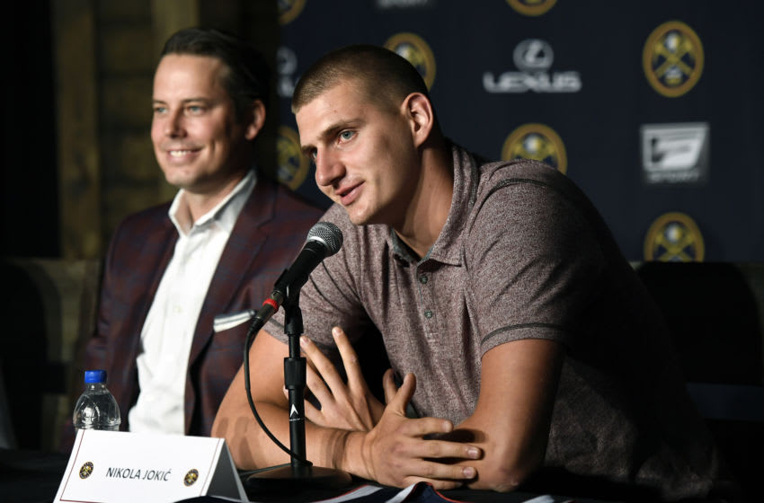 DENVER, CO - JULY 9: Nikola Jokic speaks during a press conference for Josh Kroenke, vice chairman of Kroenke Sports and Entertainment and the Nuggets to announce new contracts for Jokic and Will Barton at the Pepsi Center on July 9, 2018 in Denver, Colorado. (Photo by Joe Amon/The Denver Post via Getty Images)