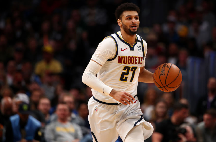 DENVER, CO - MARCH 09: Jamal Murray #27 of the Denver Nuggets dribbles up court against the Milwaukee Bucks at Pepsi Center on March 9, 2020 in Denver, Colorado. NOTE TO USER: User expressly acknowledges and agrees that, by downloading and/or using this photograph, user is consenting to the terms and conditions of the Getty Images License Agreement (Photo by Jamie Schwaberow/Getty Images)