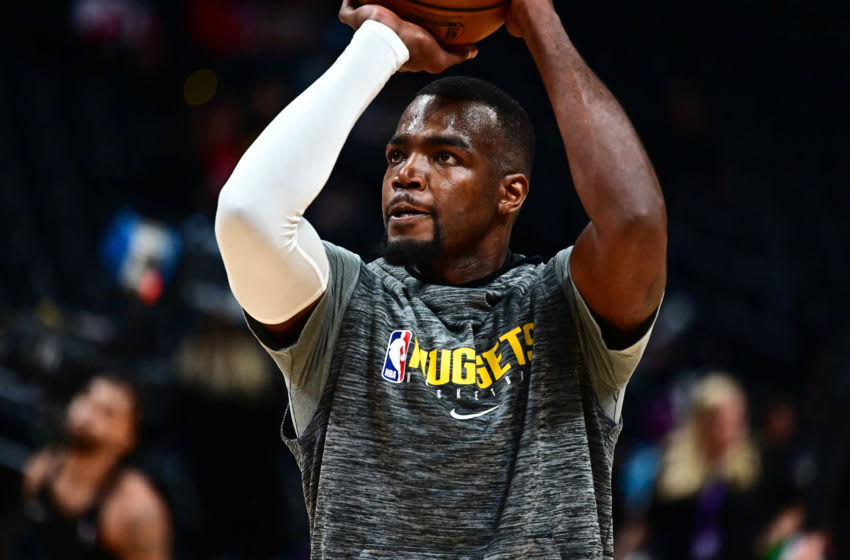 Feb 4, 2020; Denver, Colorado, USA; Denver Nuggets forward Paul Millsap (4) warms up before the game against the Portland Trail Blazers at Pepsi Center. Mandatory Credit: Ron Chenoy-USA TODAY Sports