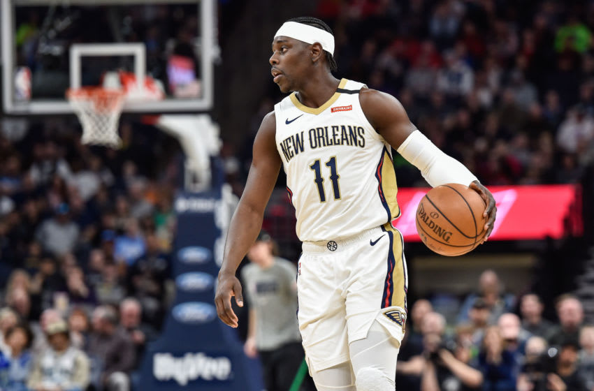 Mar 8, 2020; Minneapolis, Minnesota, USA; New Orleans Pelicans guard Jrue Holiday (11) controls the ball against the Minnesota Timberwolves during the first quarter at Target Center. Mandatory Credit: Jeffrey Becker-USA TODAY Sports
