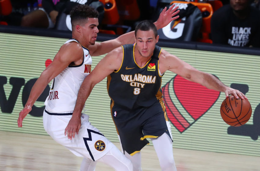 Aug 3, 2020; Lake Buena Vista, Florida, USA; Oklahoma City Thunder forward Danilo Gallinari (8) handles the ball against Denver Nuggets forward Michael Porter Jr. (1) during the second quarter in a NBA basketball game at The Arena. Mandatory Credit: Kim Klement-USA TODAY Sports