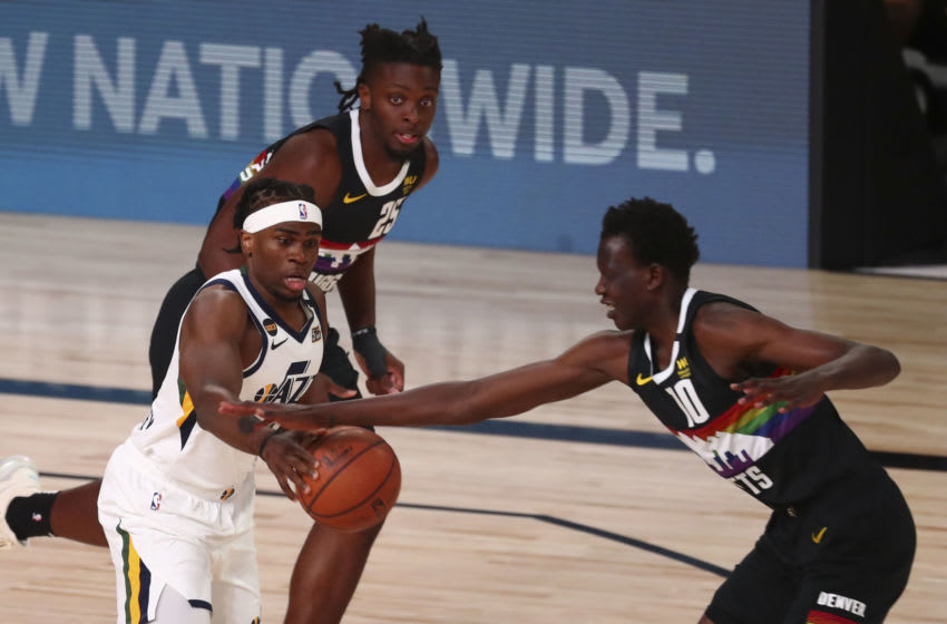 Aug 19, 2020; Lake Buena Vista, Florida, USA; Utah Jazz forward Jarrell Brantley (5) is defended by Denver Nuggets forward Tyler Cook (25) and center Bol Bol (10) in game two of the first round of the 2020 NBA Playoffs at AdventHealth Arena. Mandatory Credit: Kim Klement-USA TODAY Sports