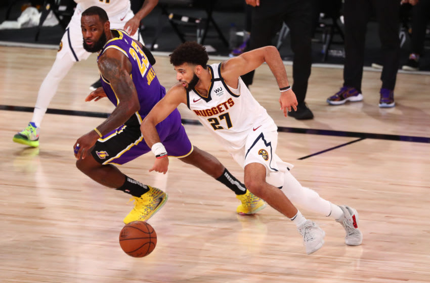 Sep 26, 2020; Lake Buena Vista, Florida, USA; Los Angeles Lakers forward LeBron James (23) chases the ball with Denver Nuggets guard Jamal Murray (27) during the fourth quarter in game five of the Western Conference Finals of the 2020 NBA Playoffs at AdventHealth Arena. Mandatory Credit: Kim Klement-USA TODAY Sports