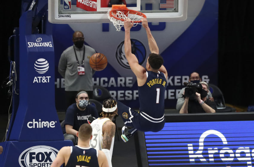 Jan 25, 2021; Dallas, Texas, USA; Denver Nuggets forward Michael Porter Jr. (1) dunks during the second quarter against the Dallas Mavericks at American Airlines Center. Mandatory Credit: Kevin Jairaj-USA TODAY Sports