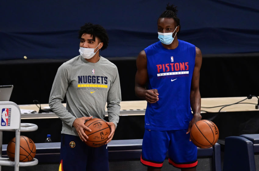 Feb 1, 2021; Denver, Colorado, USA;Detroit Pistons forward Jerami Grant (9) and Denver Nuggets guard Gary Harris (14) warm up before the game at Ball Arena. Mandatory Credit: Ron Chenoy-USA TODAY Sports