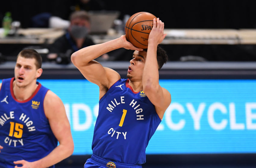 Feb 12, 2021; Denver, Colorado, USA; Denver Nuggets forward Michael Porter Jr. (1) shoots against the Oklahoma City Thunder in the second quarter at Ball Arena. Mandatory Credit: Ron Chenoy-USA TODAY Sports