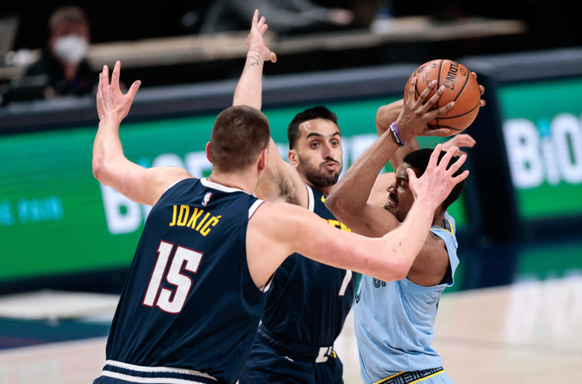 Apr 19, 2021; Denver, Colorado, USA; Memphis Grizzlies guard De'Anthony Melton (0) looks to pass the ball under pressure from Denver Nuggets center Nikola Jokic (15) and guard Facundo Campazzo (7) in the first quarter at Ball Arena. Mandatory Credit: Isaiah J. Downing-USA TODAY Sports