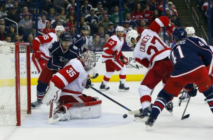 Mar 8, 2016; Columbus, OH, USA; Detroit Red Wings goalie Jimmy Howard (35) makes a save against Columbus Blue Jackets left wing Scott Hartnell (43) during the second period at Nationwide Arena. Mandatory Credit: Russell LaBounty-USA TODAY Sports